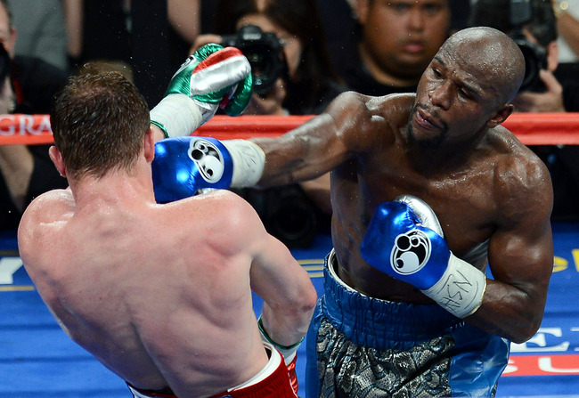 Hi-res-180623324-floyd-mayweather-jr-hits-canelo-alvarez-in-the-seventh_crop_650