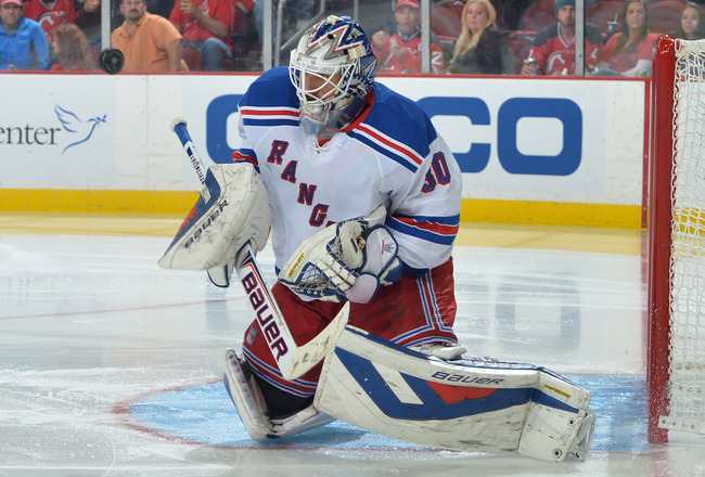 Hi-res-185824903-henrik-lundqvist-of-the-new-york-rangers-makes-a-save_crop_650x440