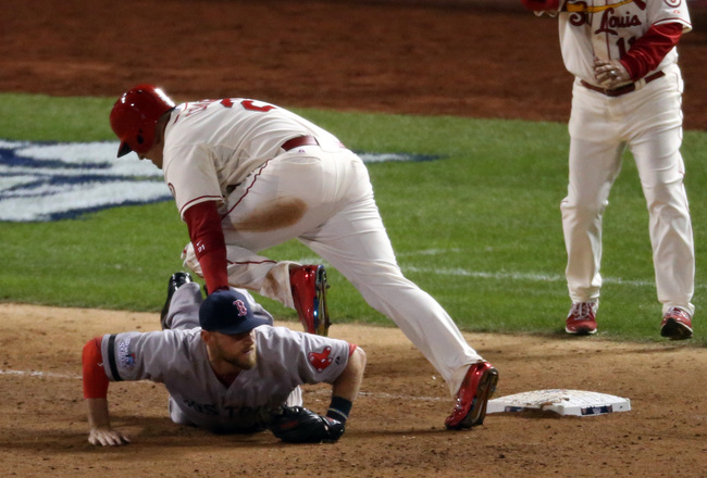 Hi-res-185982589-allen-craig-of-the-st-louis-cardinals-gets-tripped-up_crop_650x440