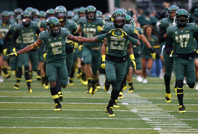 Hi-res-185971236-the-oregon-ducks-run-onto-the-field-before-the-game_crop_650x440