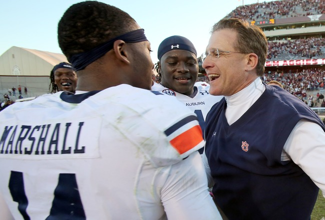 Hi-res-185369460-nick-marshall-of-the-auburn-tigers-hugs-head-coach-gus_crop_650x440