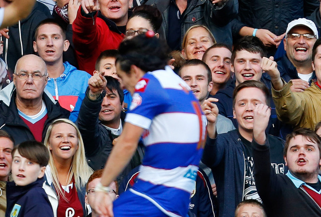 Hi-res-185928779-burnley-fans-shout-abuse-towards-joey-barton-of-qpr-as_crop_650x440