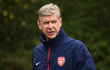 Hi-res-185469408-arsenal-manager-arsene-wenger-looks-on-during-an_display_image