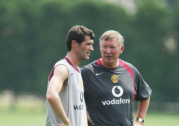 Hi-res-51106038-footballer-roy-keane-and-manager-sir-alex-ferguson-stand_display_image