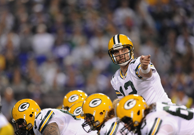 Hi-res-186060019-aaron-rodgers-of-the-green-bay-packers-calls-a-play-at_crop_650