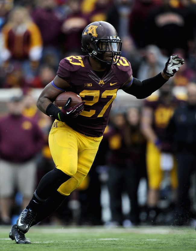Hi-res-185954823-david-cobb-of-the-minnesota-golden-gophers-carries-the_crop_650