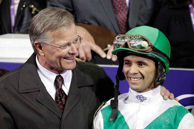 Hi-res-131459643-trainer-bill-mott-talks-with-jockey-jose-lezcano-in-the_crop_650