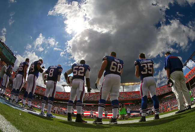 Hi-res-185421975-the-buffalo-bills-wait-to-take-the-field-during-a-game_crop_650x440