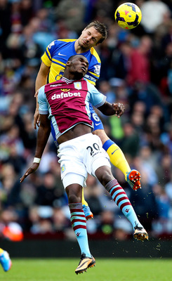 Hi-res-185933210-christian-benteke-of-aston-villa-battles-in-the-air_display_image