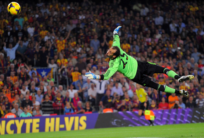 Hi-res-185942268-diego-lopez-of-real-madrid-cf-fails-to-stop-alexis_crop_650x440