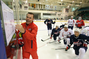 Hi-res-180540403-head-coach-adam-oates-of-the-washington-capitals-goes_display_image