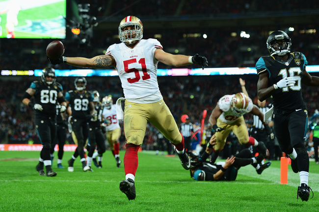 LONDON, ENGLAND - OCTOBER 27:  #51 Dan Skuta of the San Francisco 49ers scores a touchdown during the NFL International Series game between San Francisco 49ers and Jacksonville Jaguars at Wembley Stadium on October 27, 2013 in London, England.  (Photo by