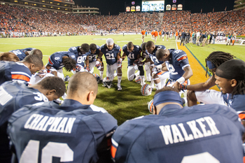 Hi-res-185978929-auburn-tigers-players-pray-before-their-game-against_display_image