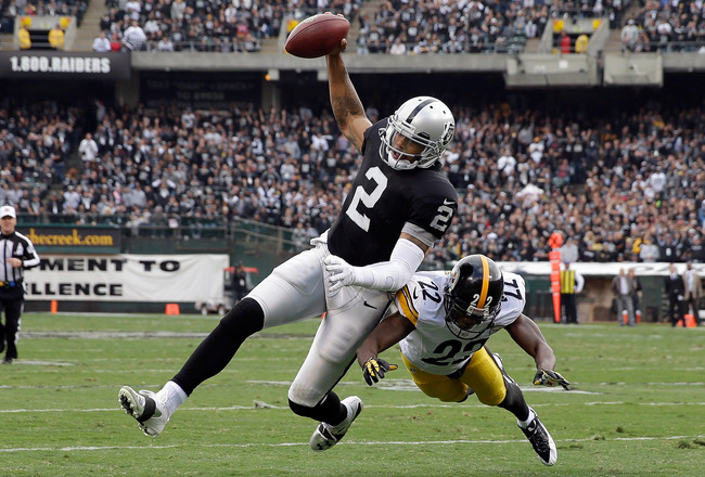 Hi-res-186050359-terrelle-pryor-of-the-oakland-raiders-is-tackled-by_crop_650x440