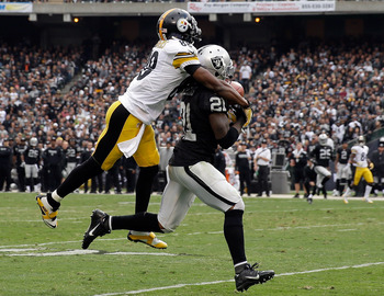 Hi-res-186054449-mike-jenkins-of-the-oakland-raiders-intercepts-a-pass_display_image