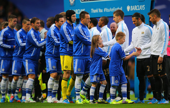 Hi-res-186020657-the-teams-greet-each-other-at-the-start-of-the-match_display_image
