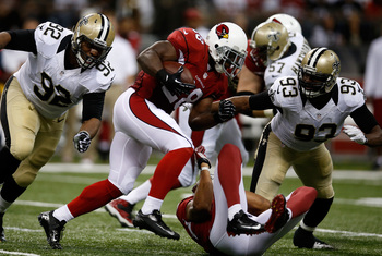 Hi-res-181566392-rashard-mendenhall-of-the-arizona-cardinals-is-tackled_display_image
