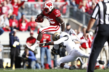 Hi-res-181469071-melvin-gordon-of-the-wisconsin-badgers-hurdles-a_display_image