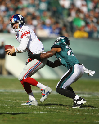 Hi-res-186034194-eli-manning-of-the-new-york-giants-eludes-the-grasp-of_display_image