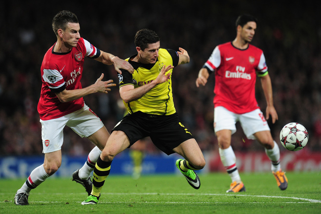 Hi-res-185582822-laurent-koscielny-of-arsenal-and-robert-lewandowski-of_crop_650