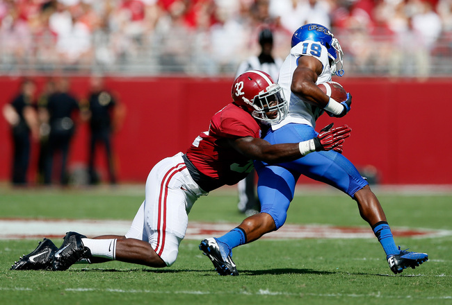 Hi-res-183161710-mosley-of-the-alabama-crimson-tide-tackles-robert-davis_crop_650x440