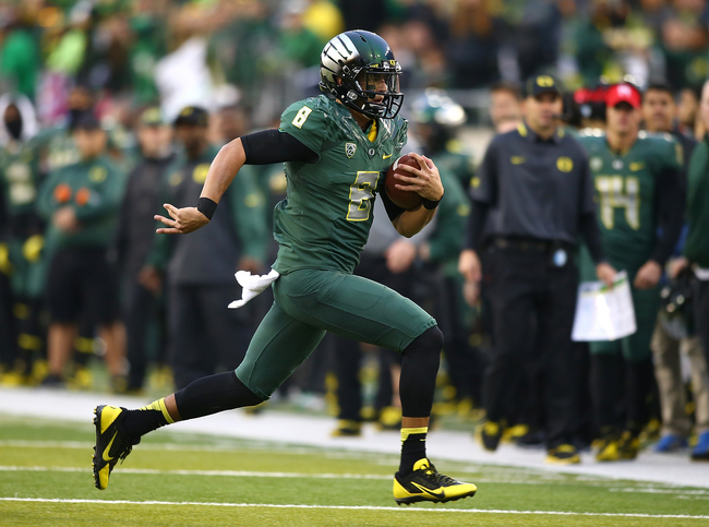 Hi-res-185978662-quarterback-marcus-mariota-of-the-oregon-ducks-runs_crop_650