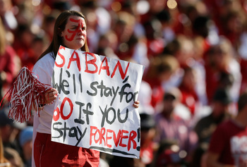 Hi-res-185960827-fan-holds-up-a-sign-for-head-coach-nick-saban-of-the_display_image