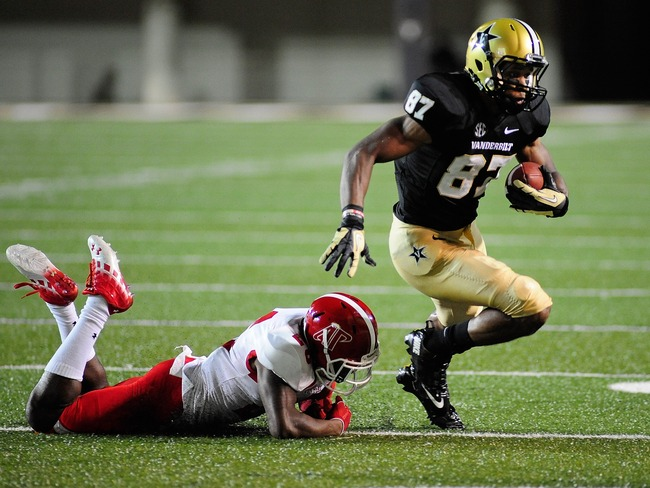 Hi-res-180002679-jordan-matthews-of-the-vanderbilt-commodores-breaks-a_crop_650