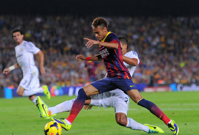 Hi-res-185954646-neymar-of-fc-barcelona-is-tackled-by-raphael-varane-of_crop_650x440
