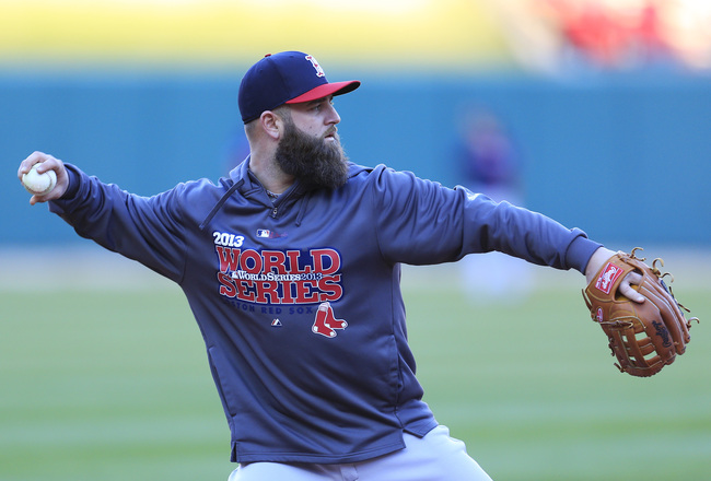 Hi-res-186053922-mike-napoli-of-the-boston-red-sox-fields-a-ball-during_crop_650x440