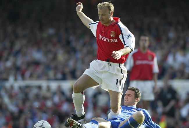 Hi-res-1005546-apr-2002-dennis-bergkamp-of-arsenal-is-tackled-by-tommy_crop_650x440