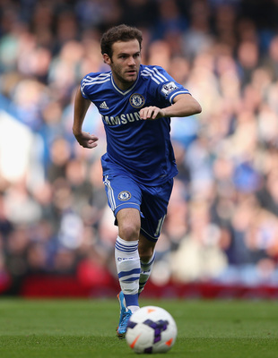 Hi-res-185350233-juan-mata-of-chelsea-runs-with-the-ball-during-the_display_image