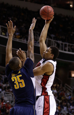 Hi-res-164245086-khem-birch-of-the-unlv-rebels-shoots-over-richard_display_image