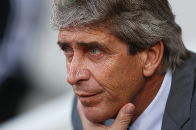 Hi-res-185351142-manuel-pellegrini-the-manchester-city-manager-looks-on_crop_650