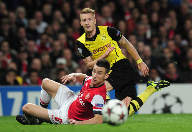Hi-res-185625354-marco-reus-of-borussia-dortmund-and-laurent-koscielny_crop_650