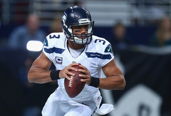 Hi-res-186147027-russell-wilson-of-the-seattle-seahawks-looks-to-pass_display_image