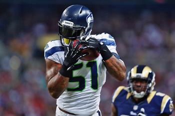 Hi-res-186147061-bruce-irvin-of-the-seattle-seahawks-intercepts-kellen_display_image
