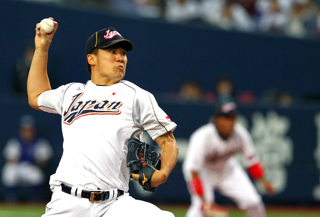 Hi-res-162423786-masahiro-tanaka-of-japan-starting-pitcher-against_crop_650x440