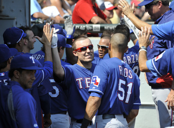 Hi-res-177645584-jeff-baker-of-the-texas-rangers-is-greeted-by-teammates_display_image