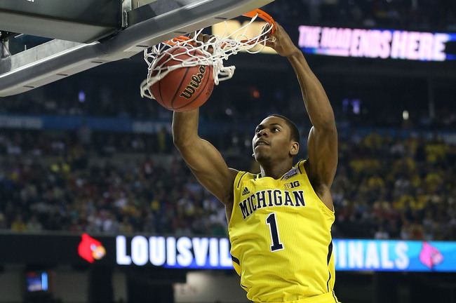 Hi-res-166089192-glenn-robinson-iii-of-the-michigan-wolverines-dunks-in_crop_650