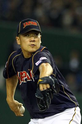 Hi-res-163368090-pitcher-masahiro-tanaka-of-japan-pitches-during-the_display_image