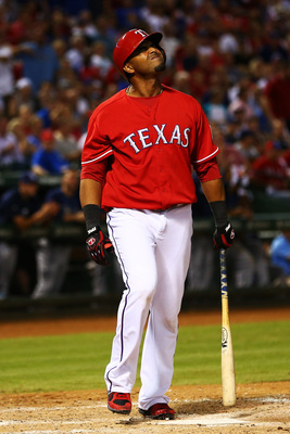 Hi-res-182565542-nelson-cruz-of-the-texas-rangers-reacts-after-striking_display_image