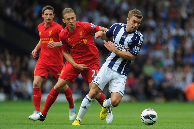 Hi-res-150451695-lucas-leiva-of-liverpool-battles-james-morrison-of-west_crop_650