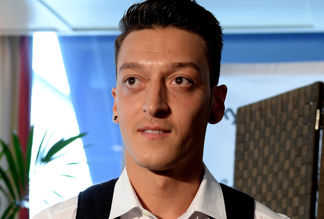 Hi-res-169915601-mesut-oezil-of-real-madrid-and-germany-looks-on-during_crop_650x440
