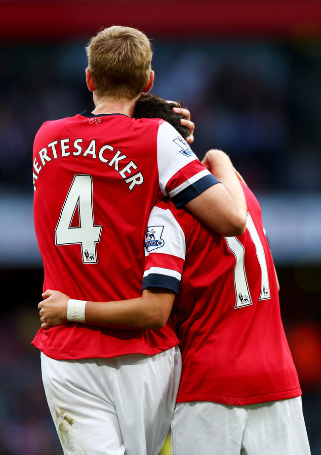 Hi-res-185349601-per-mertesacker-and-mesut-oezil-of-arsenal-celebrate_crop_650