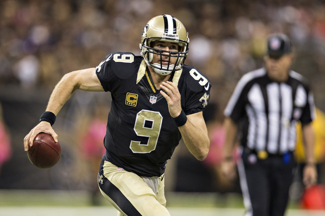 Hi-res-186046743-drew-brees-of-the-new-orleans-saints-runs-the-ball_crop_650