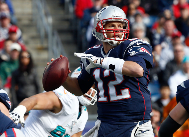 Hi-res-186038306-tom-brady-of-the-new-england-patriots-looks-for-an-open_crop_650