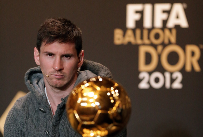 Hi-res-159064968-lionel-messi-of-barcelona-watches-ballon-dor-trophy_crop_650x440
