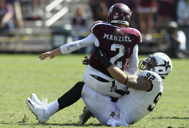 Hi-res-185942969-johnny-manziel-of-the-texas-a-m-aggies-is-sacked-by_crop_650x440