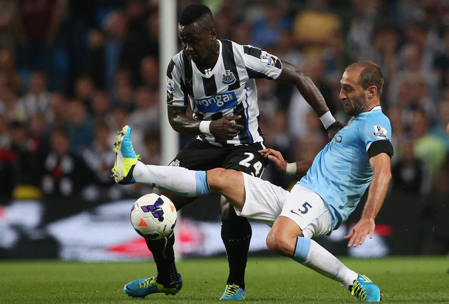 Hi-res-176927696-pablo-zabaleta-of-manchester-city-in-action-with-cheik_crop_650x440